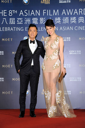 Celebrity Juror of the 8th Asian Film Awards Donnie Yen arrives on the red carpet hand-in-hand with his wife Cecilia Wang
