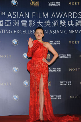 Ms Carina Lau, celebrity juror of the 8th AFA, arrives on the red carpet in a bold red number