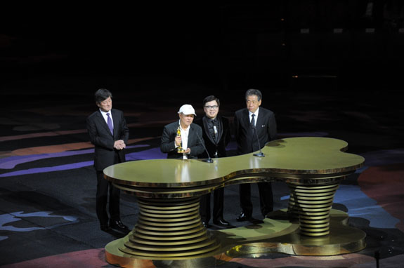 Mr Hou Hsiao Hsien receives the top honour at the 8th Asian Film Awards ceremony, the Lifetime Achievement Award, from the executive committee members of the AFAA
