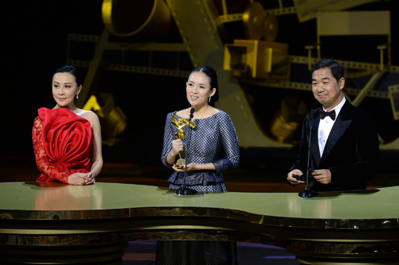 Zhang Ziyi receives the Best Actress Award for her performance in The Grandmaster from celebrity juror Carina Lau and Zhang Guoli