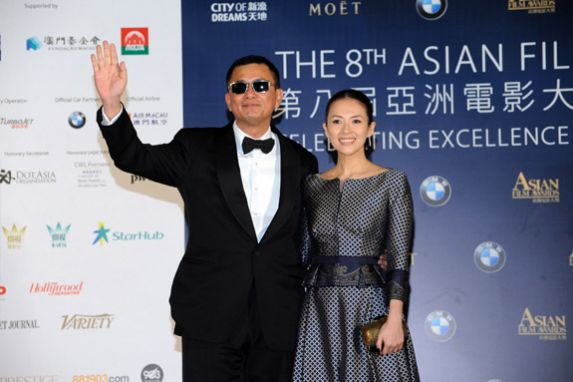 Film Director Wong Kar Wai arrives on the red carpet with Actress Zhang Ziyi